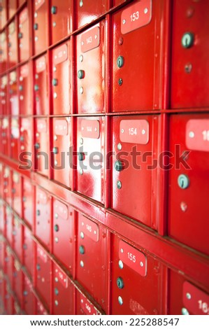 row of red safety box - stainless panel key lock numbers post office mail communication secure - stock photo