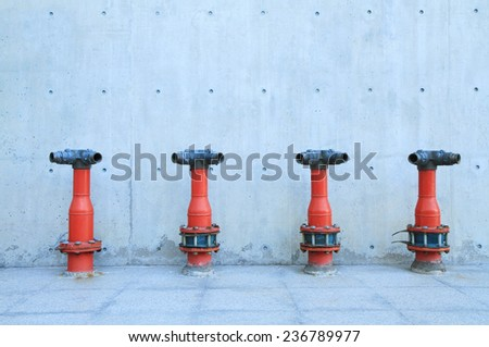 Row of red water plugs - stock photo