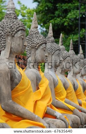 Row of Sacred Buddha images in Ayuthaya, Thailand - stock photo