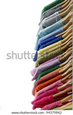 Row of shirt cloth hangers in row - stock photo