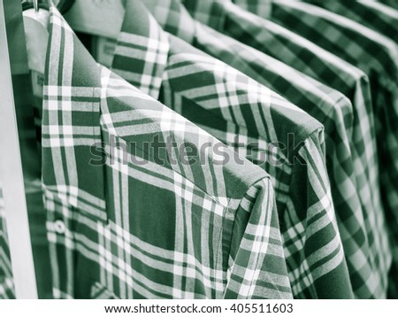row of shirts - stripes garment collection textile style Black and white image. - stock photo