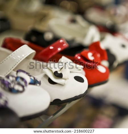 Row of slip-on shoes in a footwear shop - stock photo