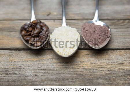 row of spoons with rice, coffee and cocoa - stock photo