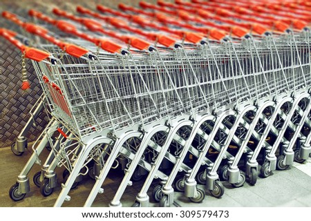 Row of Stacked Supermarket Trolleys - stock photo