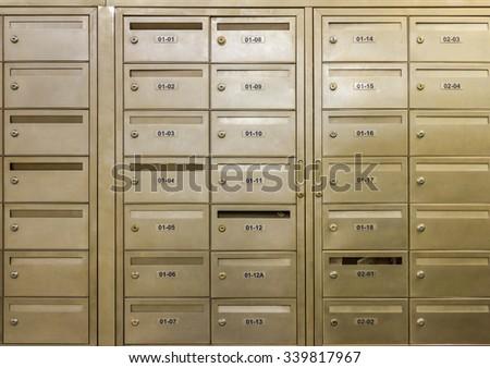 Row of steel lockers on background. - stock photo