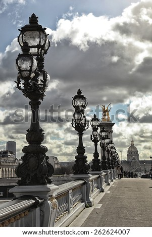 Row of street lamp with the institute of France in background - stock photo