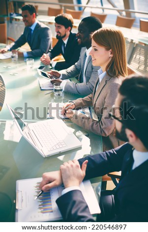 Row of successful business people listening to presentation in conference hall  - stock photo