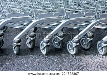 Row of supermarket karts tidy put together  - stock photo
