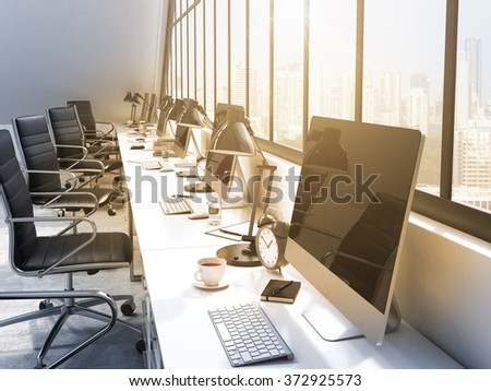 row of tables in front of the panoramic window in an office. Computers and stuff on them. City view. Filter. Concept of a modern office. 3D rendering - stock photo