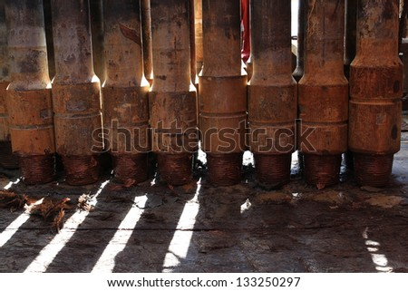 Row of Tool Joint at Pin End of Drillpipe Standing On the floor - stock photo