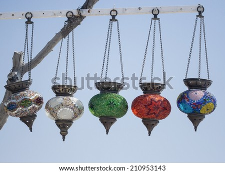 Row of Turkish mosaic lamps with sky background - stock photo