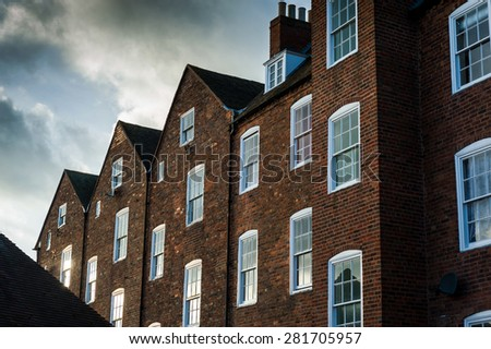 Row of typical English houses on a stormy day. - stock photo