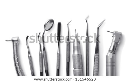 Row of various dental tools isolated on white - stock photo
