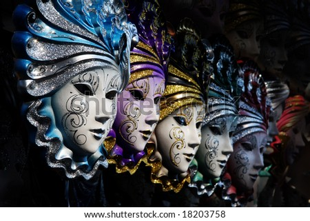Row of venetian masks in gold and blue - stock photo