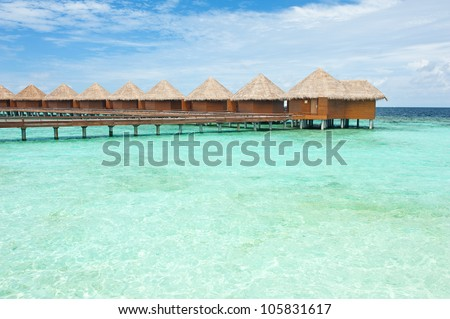 Row of water villas in the Maldives - stock photo