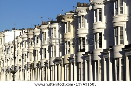 Row of white houses in London Bayswater district - stock photo