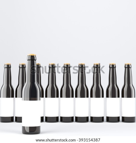 Row of wine bottles with blank labels, one in front. Dark glass. Concept of wine. 3D rendering - stock photo