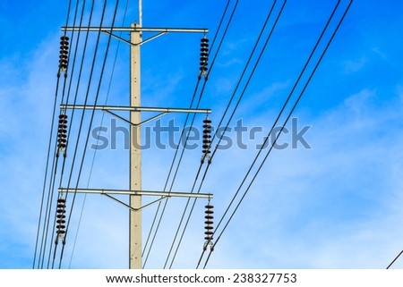 row of wire pole electricity post - stock photo