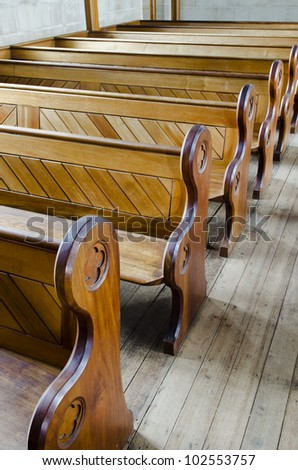 Row of wooden church pews - stock photo