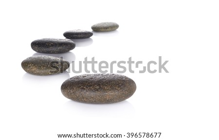 Row pebbles with copy space on white background - stock photo