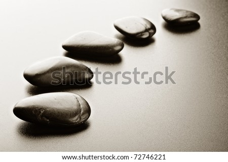 row zen stones  on the black background - stock photo
