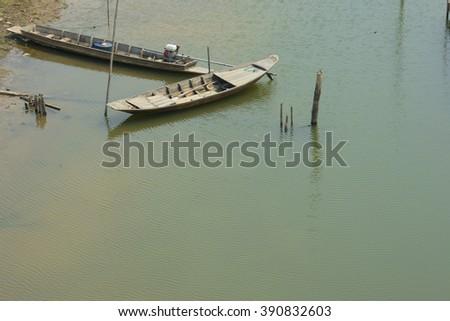 rowboat and tail boat in the river for fishing - stock photo