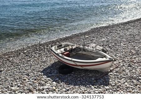 Rowboat on the beach of Greek Island of Samos, Balos beach - stock photo