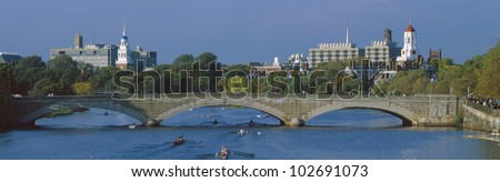 Rowers on Charles River, Harvard and Cambridge in Background, Massachusetts - stock photo