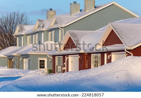 Rowhouses with piles of snow after a snow storm. - stock photo