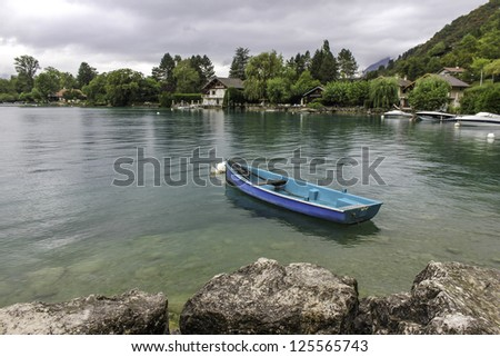 Rowing boat on peaceful lake in the Alps, Europe - stock photo