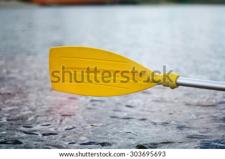 Rowing, holding a kayak paddle. Light effects - stock photo