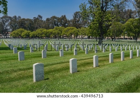 Rows of American military headstones in national cemetery in Los Angeles California - stock photo
