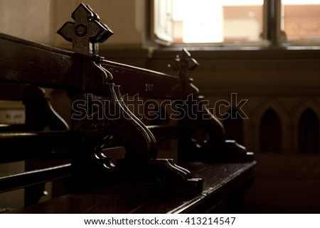 Rows of church benches by the window - stock photo