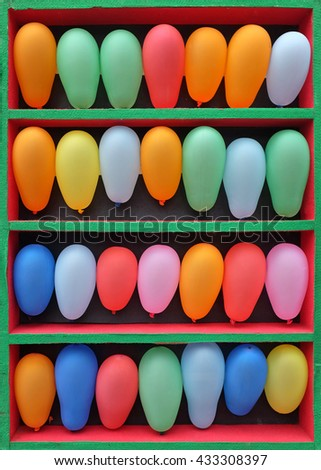 Rows of Colorful Balloons Arranged for an Arcade Skill Game, Throwing game on fair - stock photo
