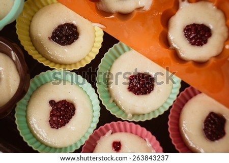 Rows of colorful cups. Muffins preparation at  home. - stock photo