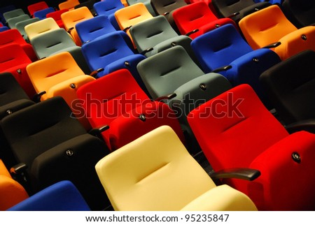 Rows of colorful theater seats - stock photo