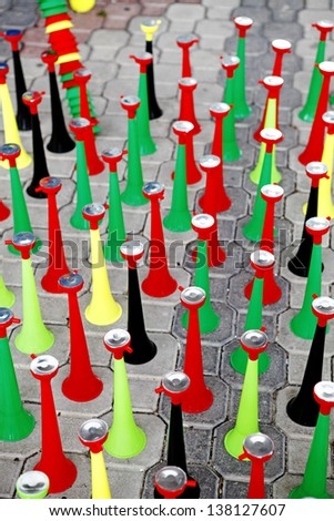 Rows of colorful vuvuzela on display.  - stock photo