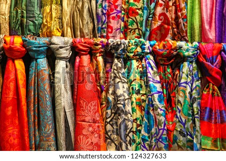 Rows of colourful silk scarfs hanging at a market stall in Istanbul, Turkey - stock photo