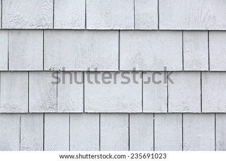 Rows of damp whitewashed cedar shingles after a rainstorm. - stock photo