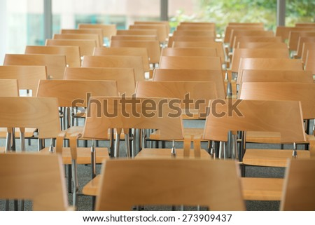 Rows of empty chairs in office - stock photo