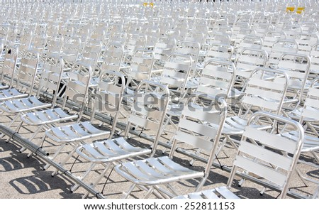Rows of empty metal chair seats installed for some business event or performance,festival - stock photo