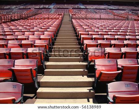 Rows of empty orange stadium seats going upward. Candlestick stadium San Francisco - stock photo