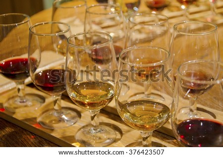 Rows of glasses with red and white wine - stock photo