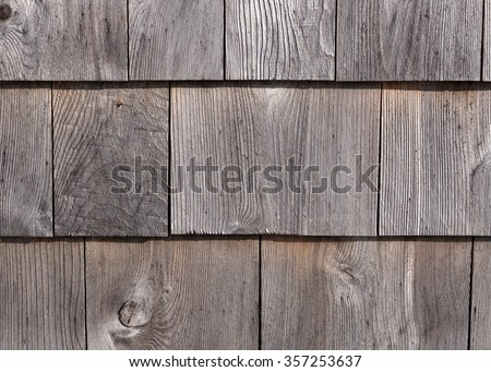 Rows of graying red cedar on an exterior wall weathered by exposure. - stock photo