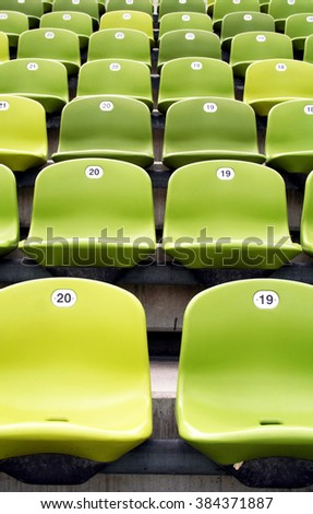 Rows of green chairs in a sport stadium - stock photo