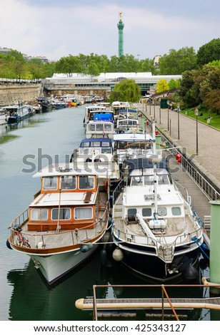 Rows of houseboats docked at  Bassin de l'Arsenal near Place de la Bastille in cloudy day. Paris (France). - stock photo