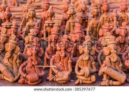 Rows of little clay puppets for sale at a handicrafts fair in Kolkata, India - stock photo