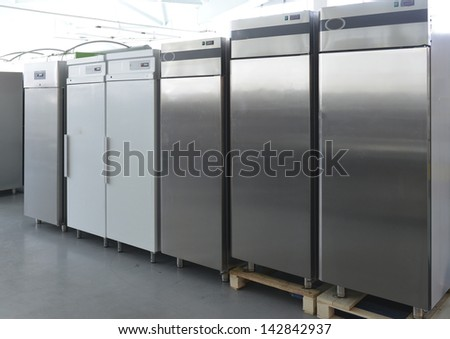 Rows of modern fridges in a store - stock photo