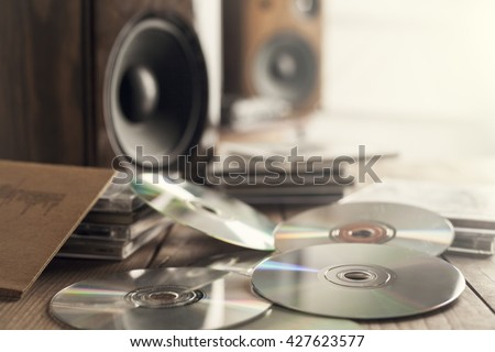 Rows of music cds with speakers - stock photo