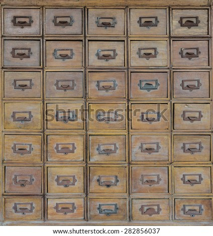 Rows of old wood drawers - stock photo